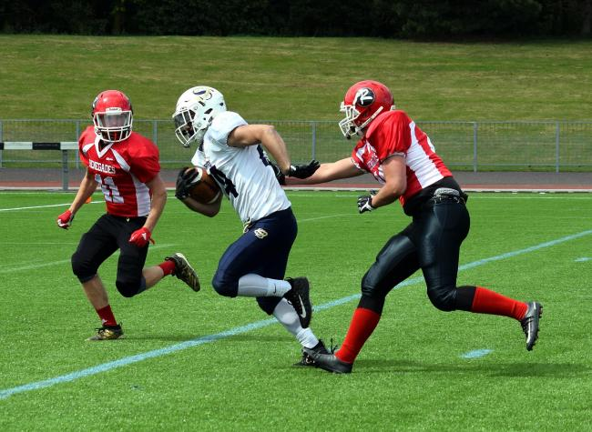 Laith Dallamy holds off two Berkshire Renegades to score Oxford Saints' only touchdown at Tilsley Park  Picture: Chris Janes