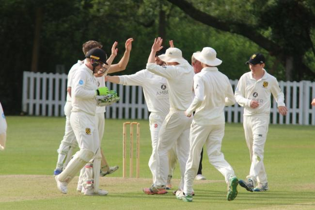 Cumnor's players mob Harry Ackland as they celebrate the dismissal of Sarisbury's Josh Hill Picture: Helen Lydford-Davis