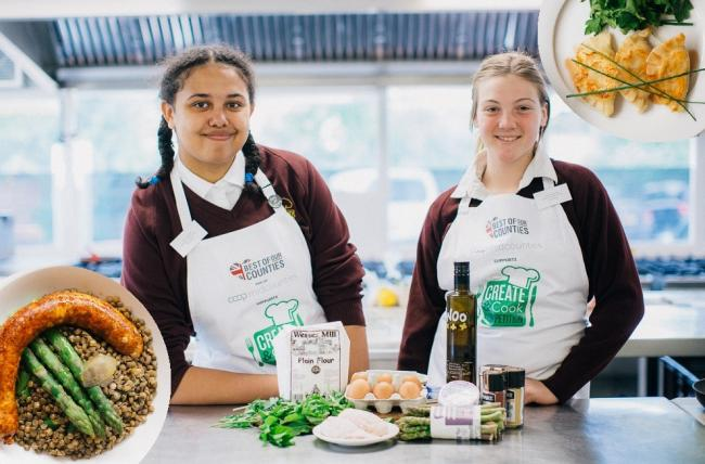Alicia Edwards, left, and Heidi Preghenella of Matthew Arnold School, Botley, at the midcounties final of the 2019 Create & Cook schools cookery competition. Inset, their dishes: a jerk-seasoned sausage made with Oxfordshire chicken, and Polish pierog