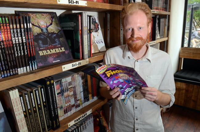 Dave Page pictured at comic book shop Inky Fingers in 2015, shortly after its opening. Picture: Marc West.