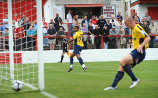 Matt Green beats Ebbsfleet goalkeeper Lance Cronin to put Oxford United ahead in Saturday's Blue Square Premier game
