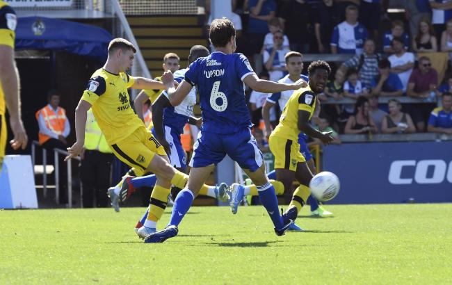 Ben Woodburn curls in his first goal for Oxford United   Picture: David Fleming