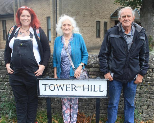 Witney residents Liz and Ken Flynn, pictured with daughter Sam, left, have been learning more about their street Picture: Owen Collins