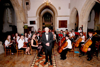 Paul Davies pictured with the Oxford Concerto Orchestra in Blewbury Church