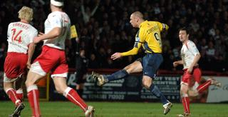 James Constable fires in a shot against Stevenage