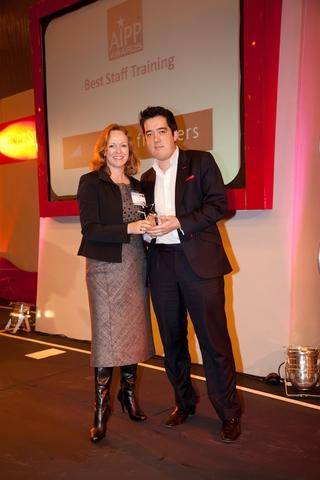 Sue Ash, chairman of the AIPP board presents an award to Property Frontiers director Ray Withers