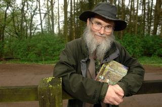 STUDIES: Ecologist Dr Keith Kirby with his book in Wytham Woods