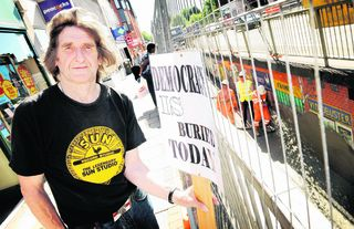 Mick Haines sees his protest end as workers spray concrete into the walkway