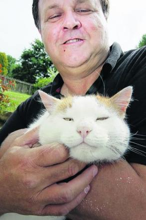 Steve Blake with his cat Fudge, who disappeared from Wendlebury in 2007 and turned up in Manchester three years later