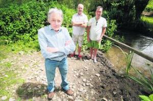 Members of the Oxford Flood Allliance, from left, Dr Peter Rawcliffe, Nick Hills and Andy Webber in North Hinksey near Hinksey Stream, which has flooded several times in the past few years