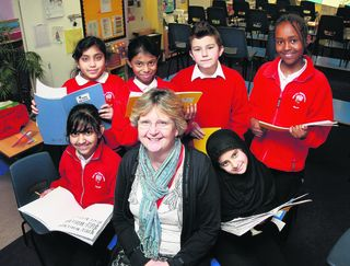 Headteacher Sue Mortimer with current Year Six pupils, back, from left, Rubina Ali, Elsha Soy, Jack Tallon, Allison Simon, front, from left, Naomi Singh and Saalehah Bibi
