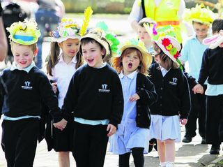 Children from Woodstock Primary School paraded through the town on Thursday in their Easter bonnets before heading to St Mary Magdalene Church for an Easter service