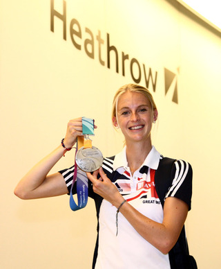 Hannah England with her silver medal at Heathrow
