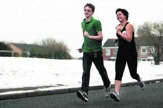 Carol MacKay and son Luke Dickety warming up for the OX5 Run. Picture: OX50338 Antony Moore