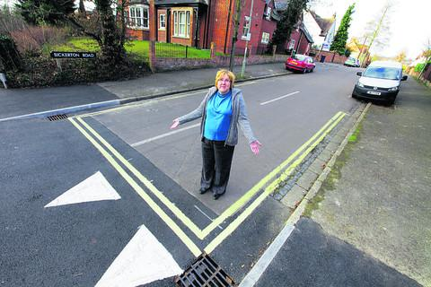 City councillor Ruth Wilkinson with one of the sets of double yellow lines