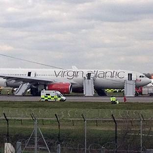 The Virgin Atlantic plane on the runway at Gatwick Airport after it made an emergency landing