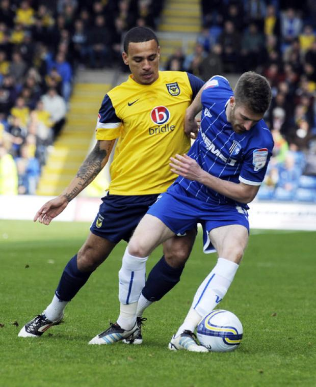 United winger Dean Morgan puts Gillingham's Matt Fish under pressure during Saturday's goalless draw