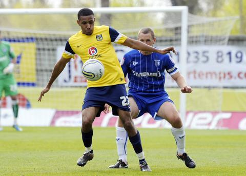 United striker Christian Montano, seen shielding the ball from a Gillingham opponent during Saturday's goalless draw, is staying until the end of the season