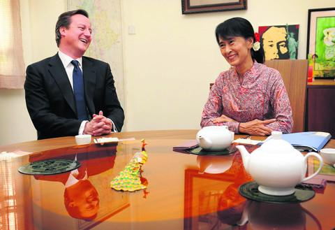 Prime Minister David Cameron enjoys tea and laughter at the lakeside villa of the Burmese opposition leader Aung San Suu Kyi. He was back in England the next day for beer and a burger at The Punter (below), beside the River Thames on Osney Island.