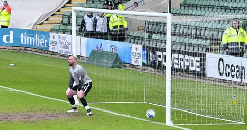 Oxford goalkeeper Wayne Brown cannot believe it as a Plymouth free-kick in just the second minute takes a wicked deflection and leaves him stranded