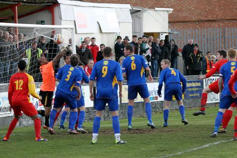Ricky Johnson (far right) glances in Banbury United's equaliser against Leamington from Ben Polk's corner