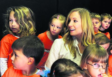 Joanne Froggatt, who plays Anna Bates in Downton Abbey, pictured with children at the workshop