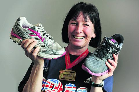 Dawn Williams with her shoe and the donated trainer. Picture: OX51595 Jon Lewis