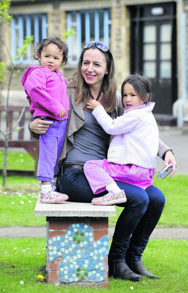 Benedicte Yue, from Drayton with daughters Lily-Rose, three, left, and India, five