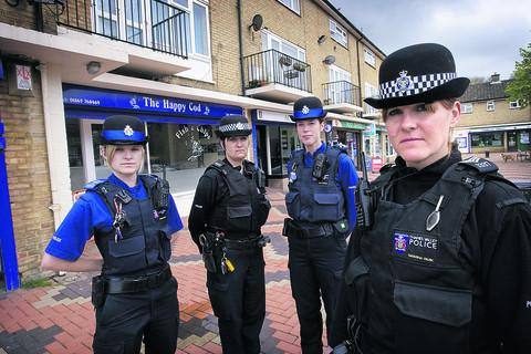 Sgt Natasha Park, right, outside the scene of a mass brawl in Atkyns Road, Wood Farm, with colleagues, from left, PCSO Kayleah George, Pc Karen Zuldan and PCSO Alex Allman