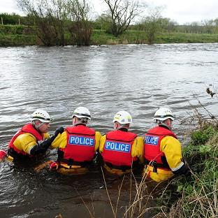 A specialist police search team searches the River Wear after an eight-year-old boy fell into the swollen river
