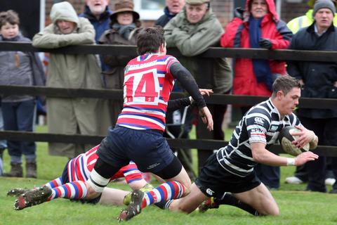 Chinnor wing Mark Chase scores against Tonbridge Juddians