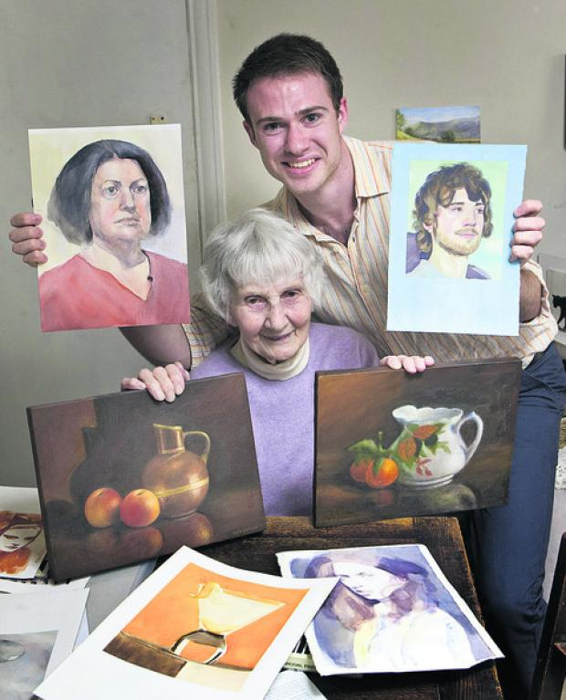 Caroline O'Connor with her grandson Will and some of their paintings