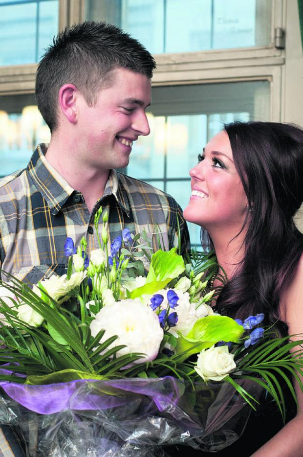 n WINNERS: Kate Harvey and Jamie Leach at the Town Hall in April last year celebrating their Win Your Wedding victory