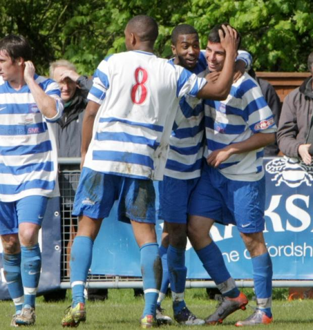 Felipe Barcelos (right) is congratulated by Declan Benjamin (8) and Marvin Martin  after putting Oxford City in front against AFC Totton
