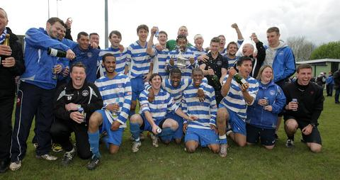 Oxford City's players and coaching staff celebrate promotion from the Evo-Stik Southern League