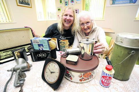 Organiser Sharon Woodward and Sadie King, 87, with memorabilia from the Down Memory Lane project