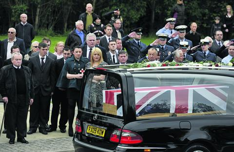 The family of Cpl Brent McCarthy watch as the cortege passes