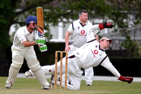 Banbury 2nd wicket-keeeper Eddie Phillips is beaten by a leg glance from Horspath's Steve Green during their Division 1 clash