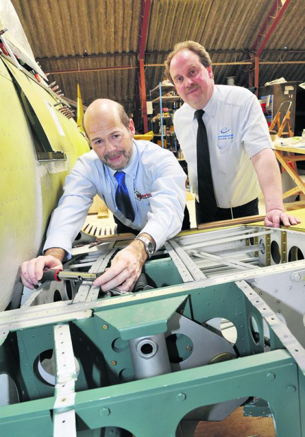 Philip Brodey, sales and marketing director at Norbar, left, and Paul Fowler, of Enstone Flying Club, use one of the new torque wrenches on a replica Spitfire