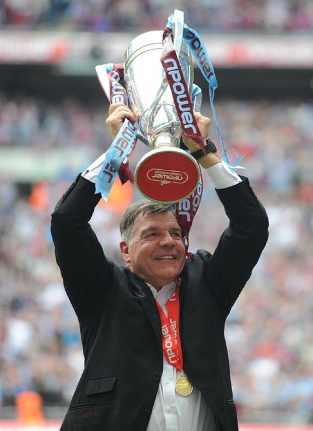West Ham boss Sam Allardyce with the Championship trophy