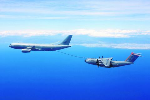 The Voyager tanker plane, left and the Airbus A400M prototype during refuelling trials