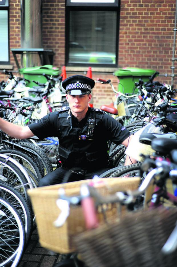 Sgt Matt Sulley with some of the unclaimed bikes