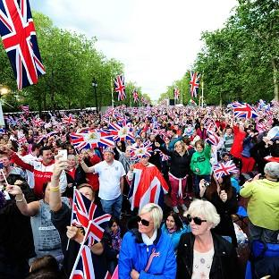 Excitement grows in front of the stage outside Buckingham Palace as the crowd awaits the Diamond Jubilee Concert (PA)