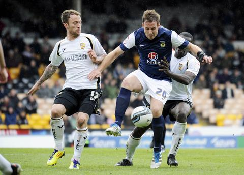 Sean Rigg (left) closes in on United's Peter Leven in the last game of the season, which Port Vale won 3-0