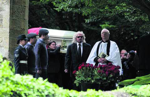 Barry Gibb walks in front of the coffin of his brother Robin as it is carried from his funeral service at St Mary's Church.