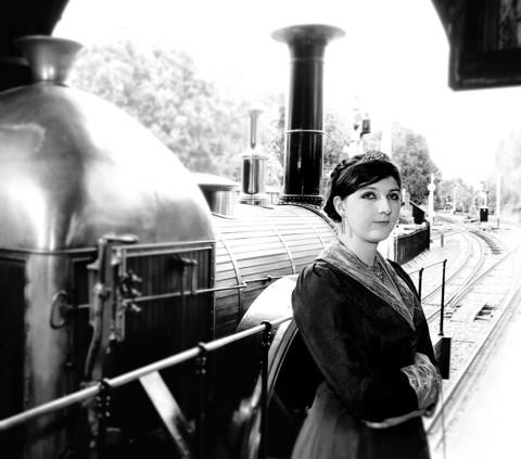 Beth Gillham in costume as Queen Victoria with replica locomotive Fire Fly