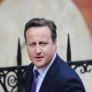 Prime Minister David Cameron arrives at the Leveson Inquiry into press standards at the Royal Courts of Justice in London