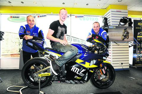 Racer Bradley Smith with Steve Polden, left, and Craig Polden