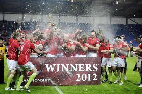 London Welsh's players celebrate victory in the Championship play-off final at the Kassam Stadium last month