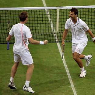 Britain's Jonathan Marray, left, and doubles partner Frederik Nielsen, of Denmark, celebrate winning the Wimbledon men's doubles final